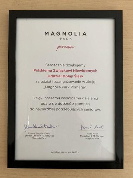 Podziękowania w czarnej ramce za udział w akcji Magnolia Park pomaga